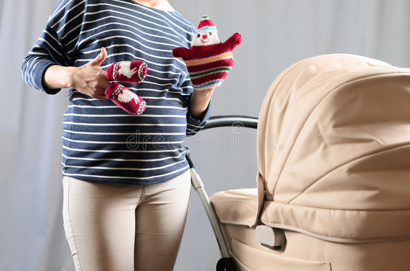 In anticipation of motherhood. Pregnant belly.  stock photos
