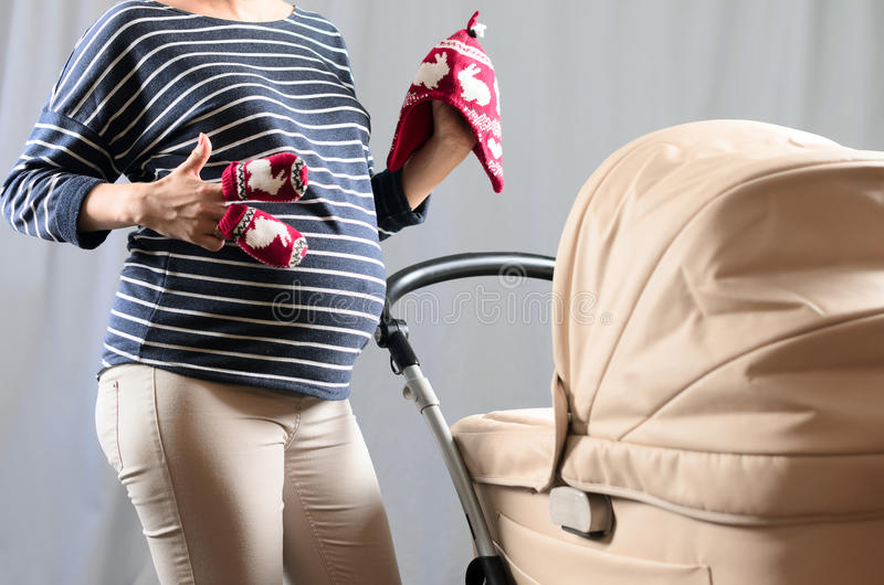 In anticipation of motherhood. Pregnant belly.  stock images