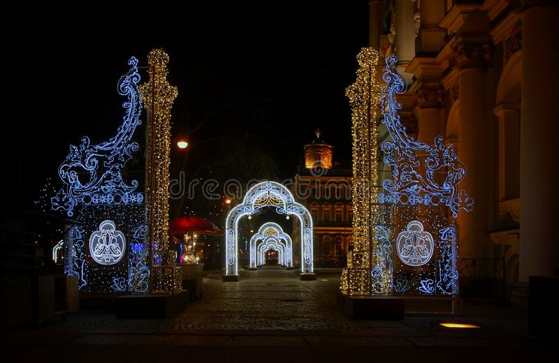 In anticipation of New Year`s magic, Festive electric garlands near the Hermitage. In St. Petersburg stock image