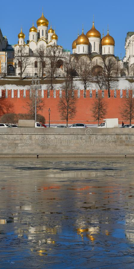 Anticipation of spring. Russian Orthodox Cathedrals in Kremlin and reflection in Moscow river. Russia stock image