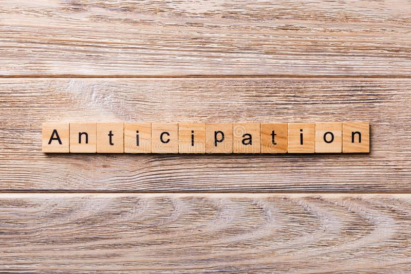 Anticipation word written on wood block. anticipation text on wooden table for your desing, concept.  stock image