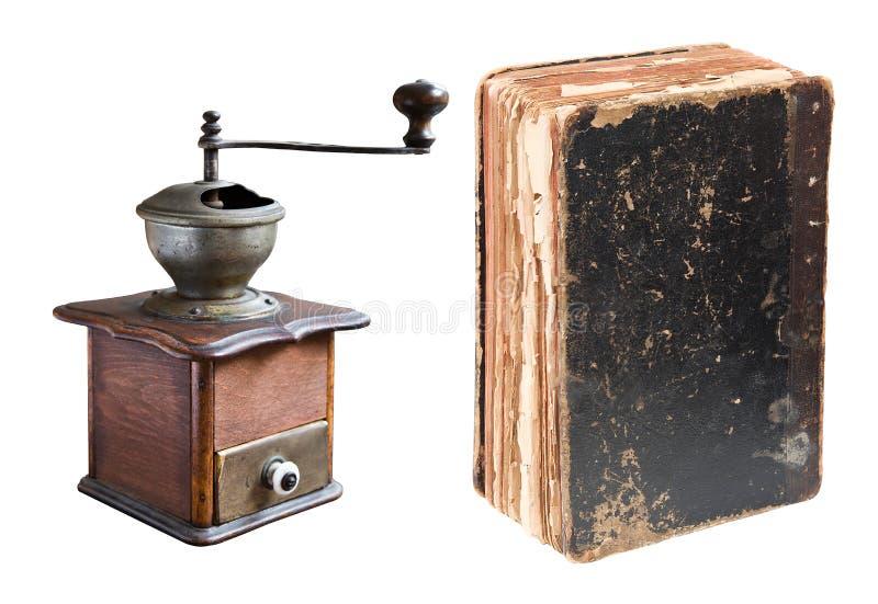 Antiek die koffiemolen en boek op wit wordt geïsoleerd royalty-vrije stock afbeeldingen
