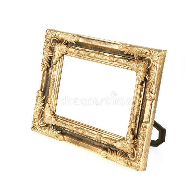Antiek gouden die fotokader op de witte achtergrond wordt geïsoleerd stock foto's
