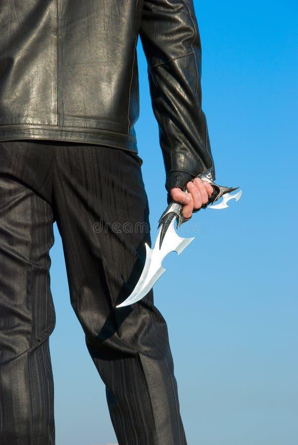 Antiek mes in een hand royalty-vrije stock afbeelding