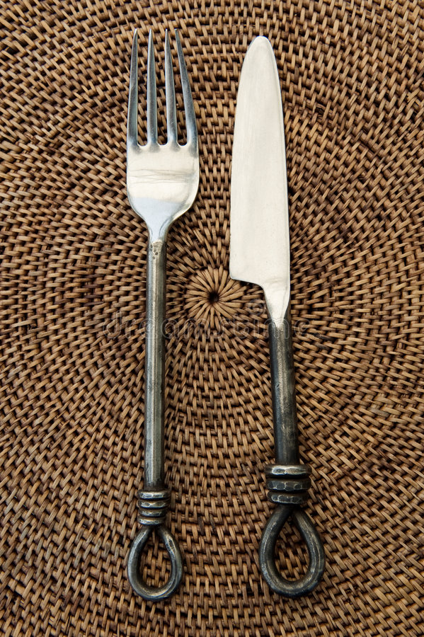 Antiek vork en mes stock afbeelding