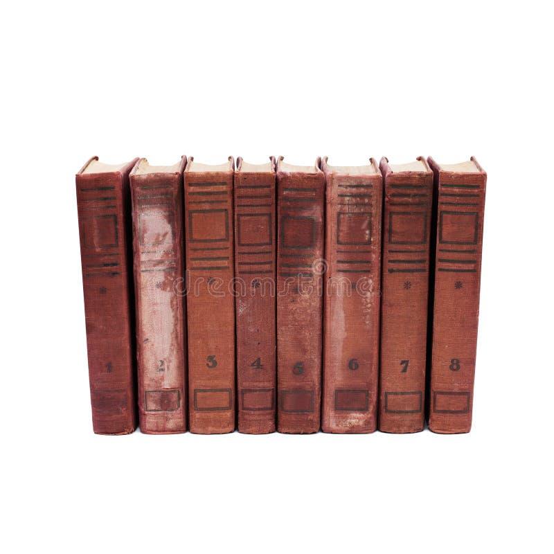 Antieke boekdekking op witte achtergrond acht volumes van antieke boeken met aantallen van 1 tot 8 Zeldzame inzameling royalty-vrije stock afbeeldingen