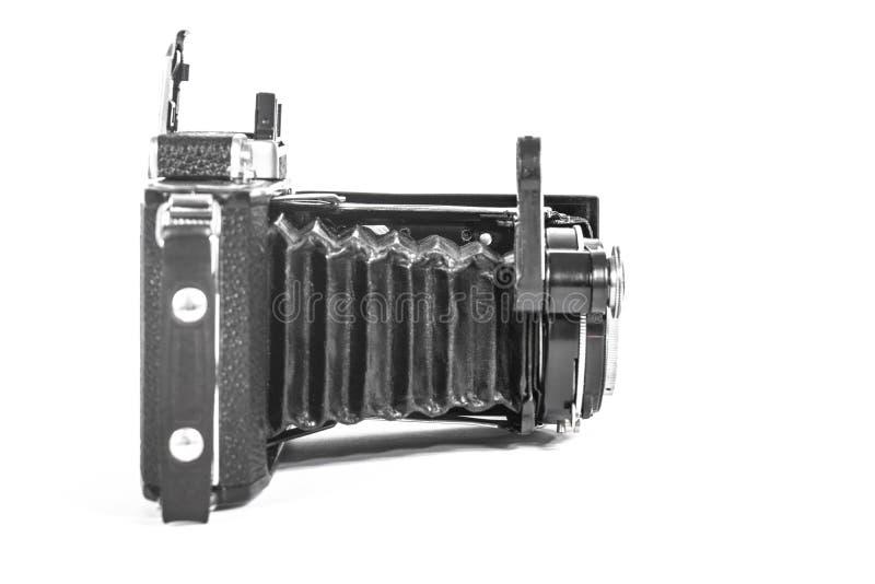 Antieke camera met een harmonikalens stock foto's