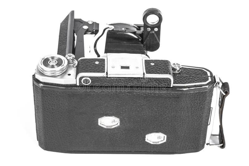 Antieke camera met een harmonikalens stock afbeeldingen