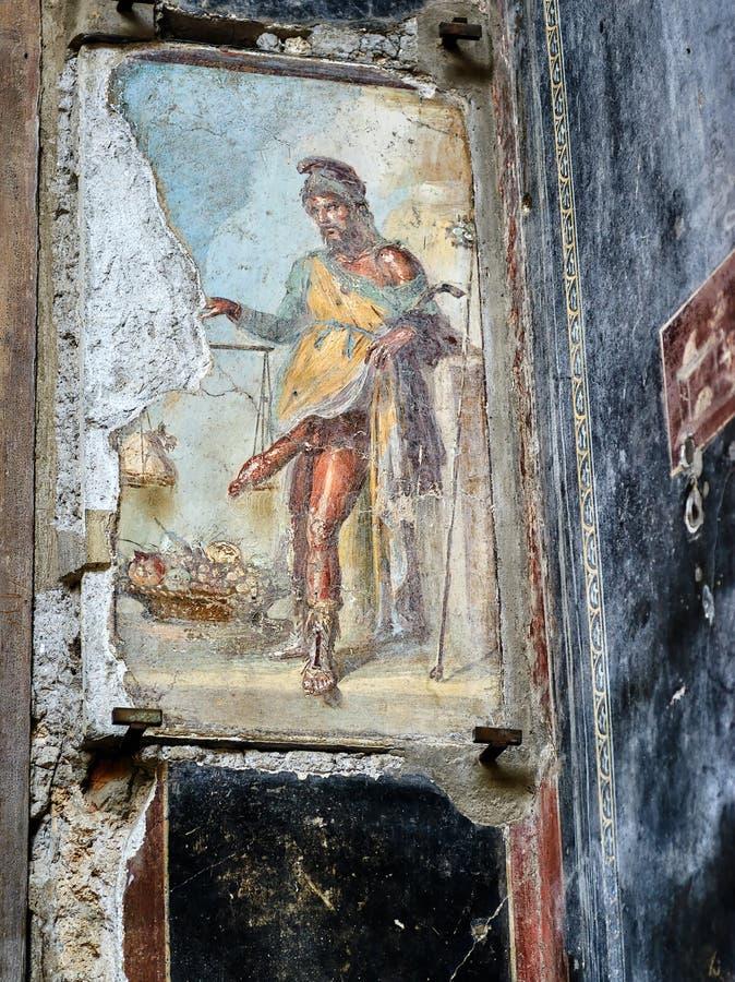 Antieke fresko die de god Priapus in Pompei, Italië afschilderen stock afbeelding