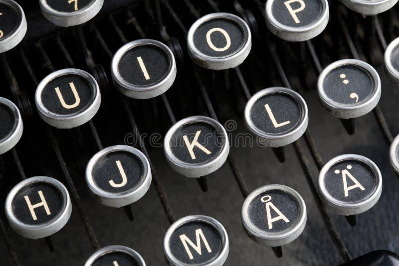 Antieke schrijfmachinesleutels. stock afbeeldingen