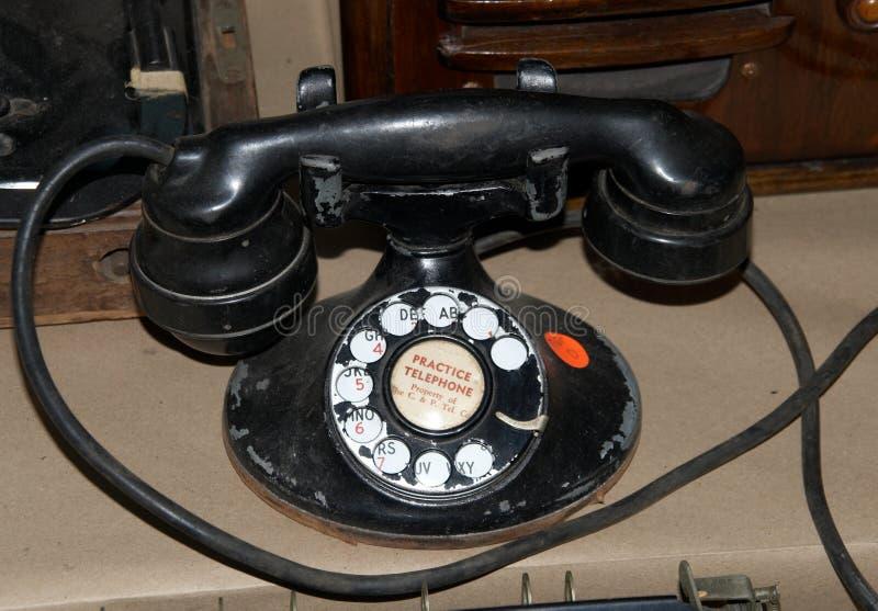 Antieke telefoon die als praktijk werd gebruikt royalty-vrije stock foto