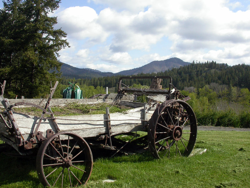 Antieke wagen mountainscape stock foto