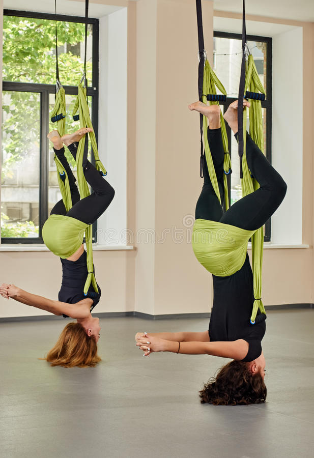 Antigravity yoga exercise. upside down royalty free stock image