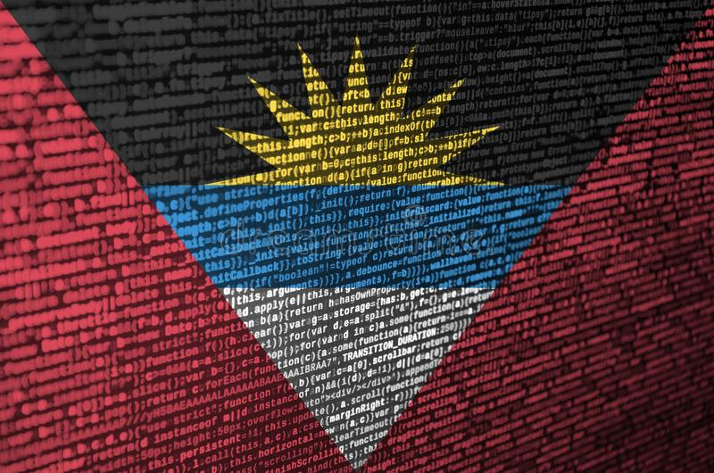 Antigua and Barbuda flag is depicted on the screen with the program code. The concept of modern technology and site development stock image