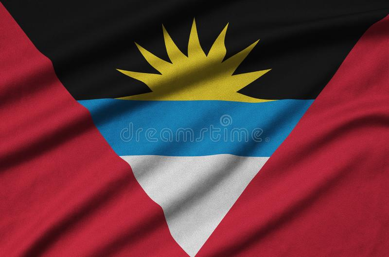 Antigua and Barbuda flag is depicted on a sports cloth fabric with many folds. Sport team banner royalty free stock photo