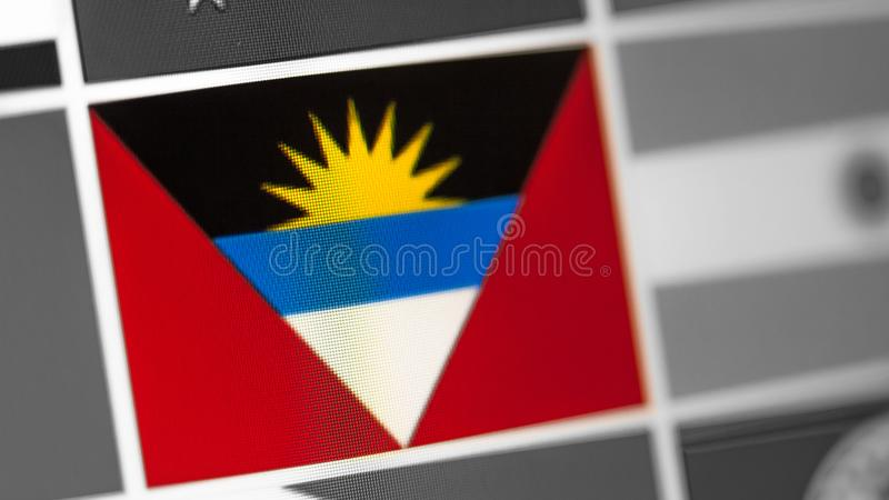 Antigua and Barbuda national flag of country. flag on the display, a digital moire effect. stock photo