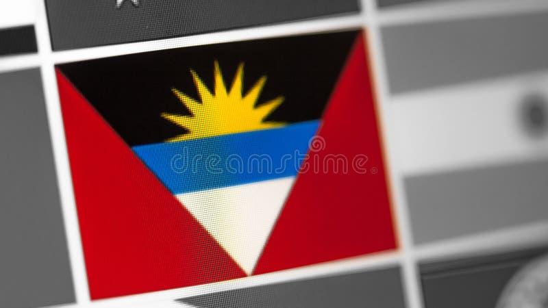Antigua en de nationale vlag van Barbuda van land vlag op de vertoning, een digitaal moiréeffect stock foto
