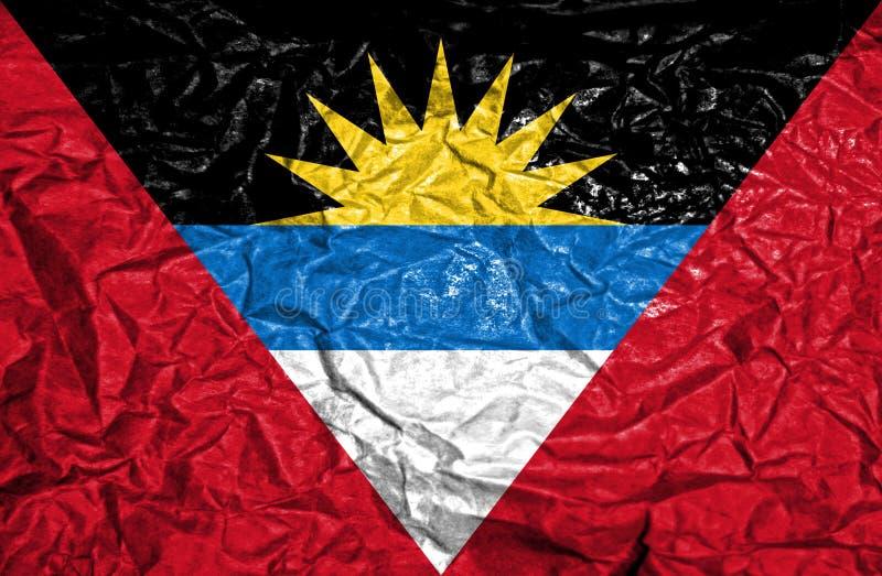 Antigua en de uitstekende vlag van Barbuda op oude verfrommelde document achtergrond royalty-vrije stock foto