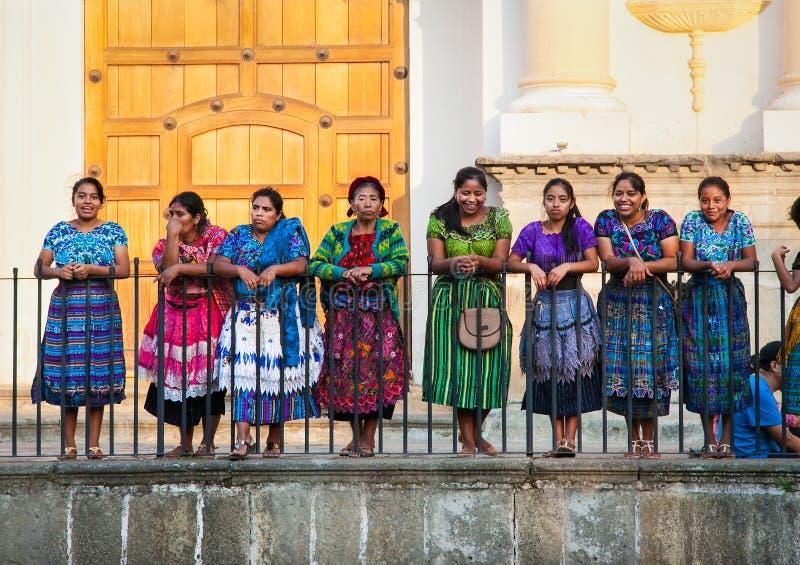 Guatamalian woman drasing in traditional dresses , Antigua, Guatemala. stock photo