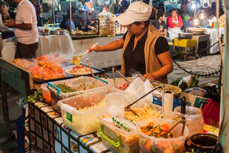 ANTIGUA, GUATEMALA - MARCH 26, 2016: Food stall at a market in Antigua Guatemala town, Guatemal stock photo