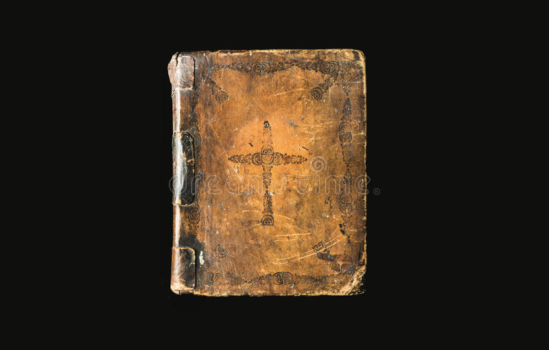 Antik bok på svart bakgrund Forntida bibel med CR royaltyfri bild