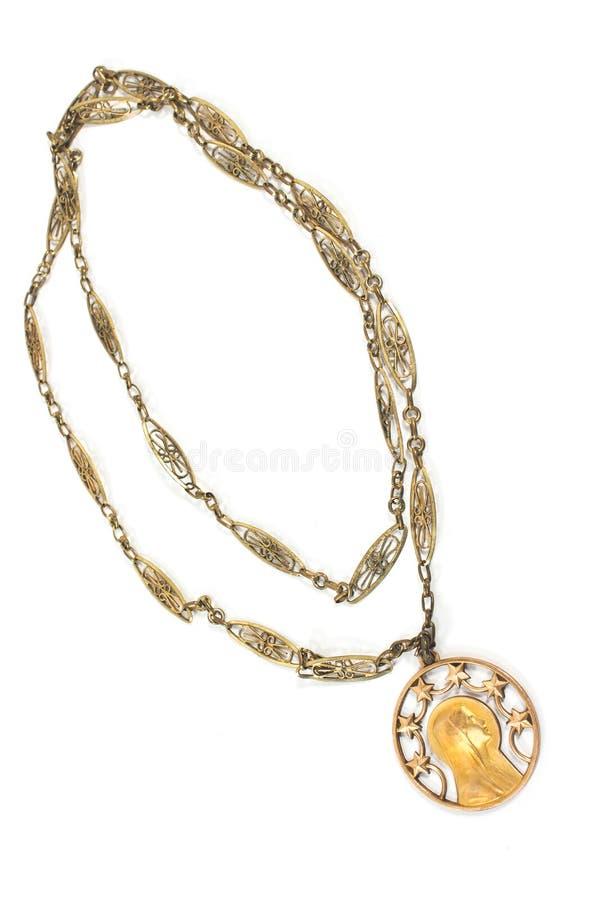 Antik halsband med den jungfruliga Mary hängen royaltyfri bild