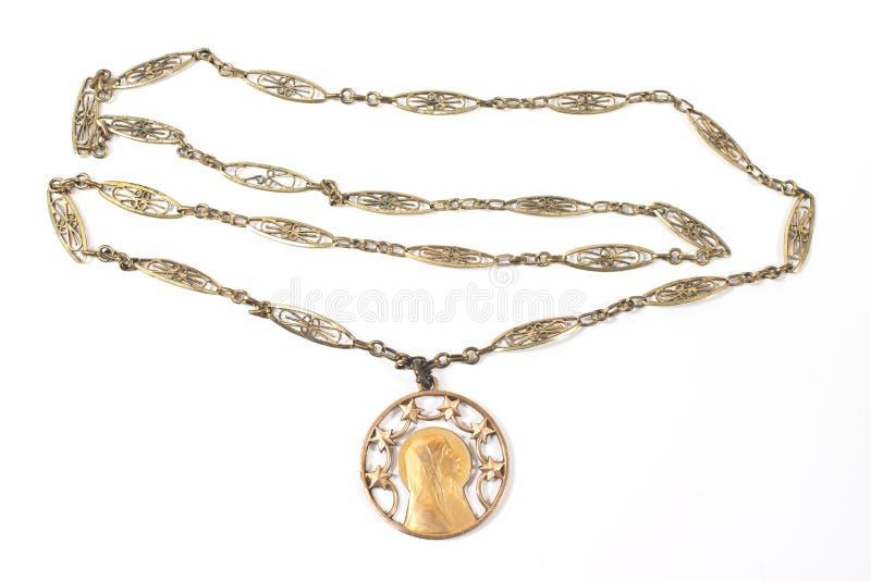 Antik halsband med den jungfruliga Mary hängen arkivfoton