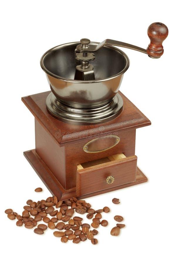Antik kaffegrinder och kaffebönor royaltyfri fotografi