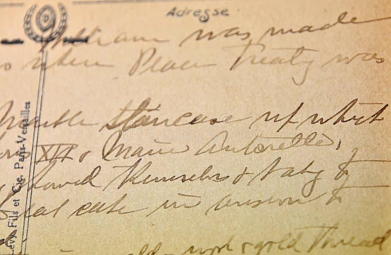 Antik skrift för tappninghandskrift på vykortet arkivbilder