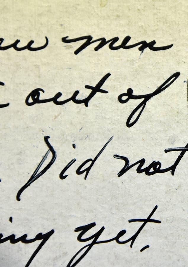 Antik skrift för tappninghandskrift på vykortet arkivfoton