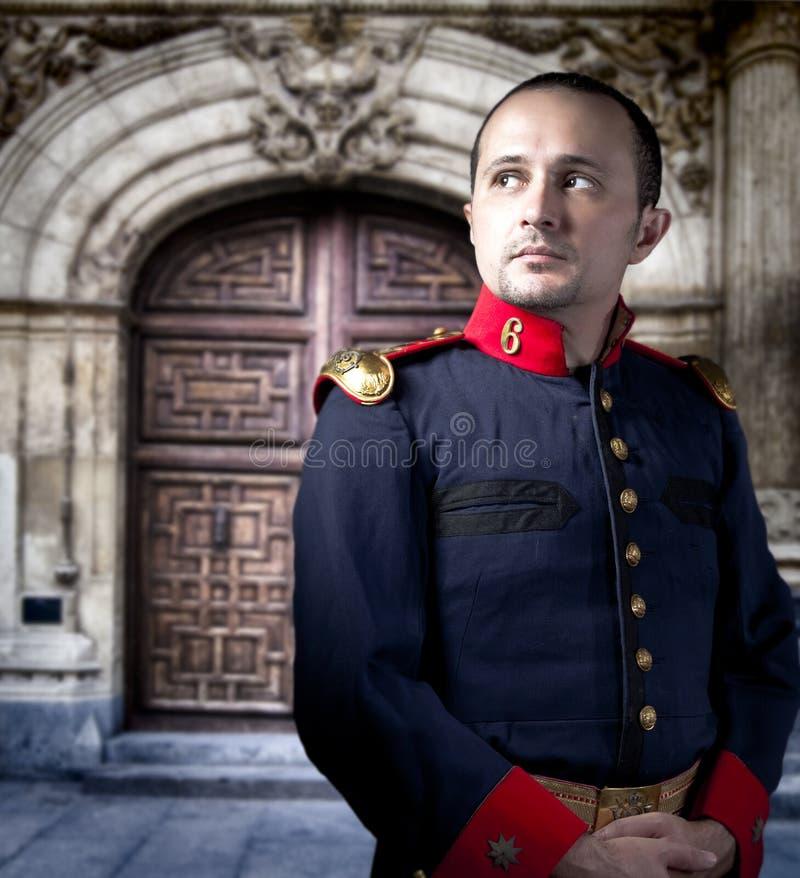 Antik soldat, man med den militära dräkten royaltyfri foto