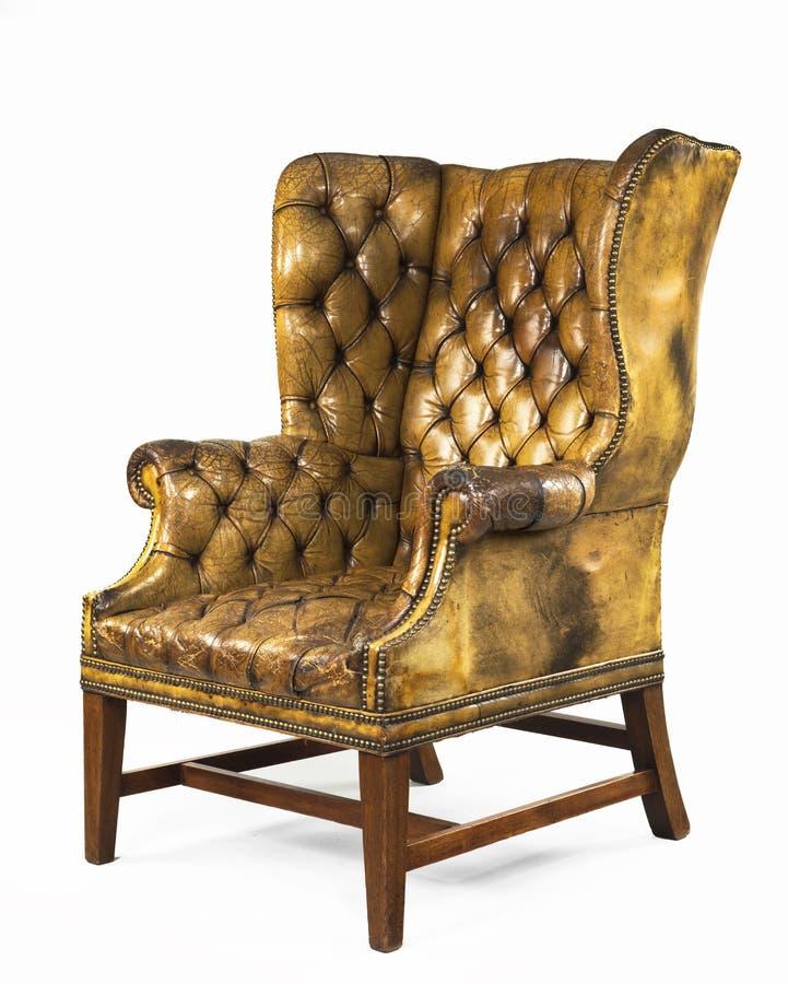Antik stol för gulinglädervingen isolerade royaltyfri fotografi