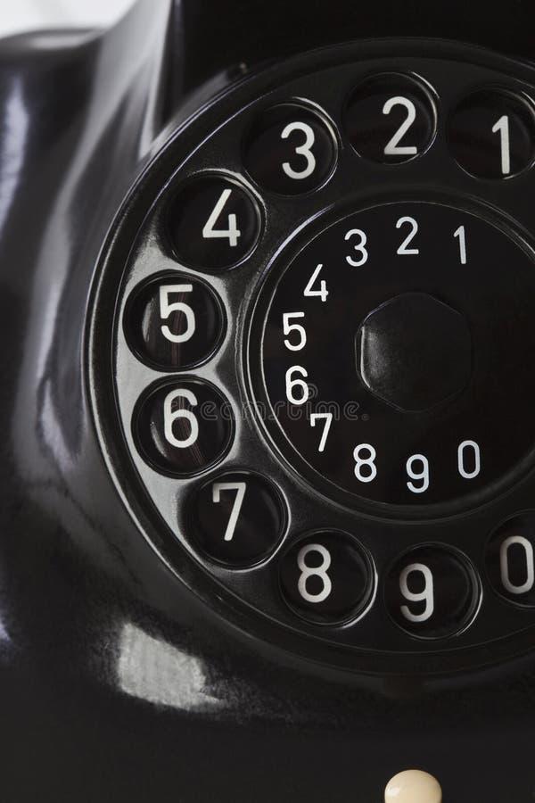Antik telefon, visartavlaplatta, slut upp royaltyfria bilder