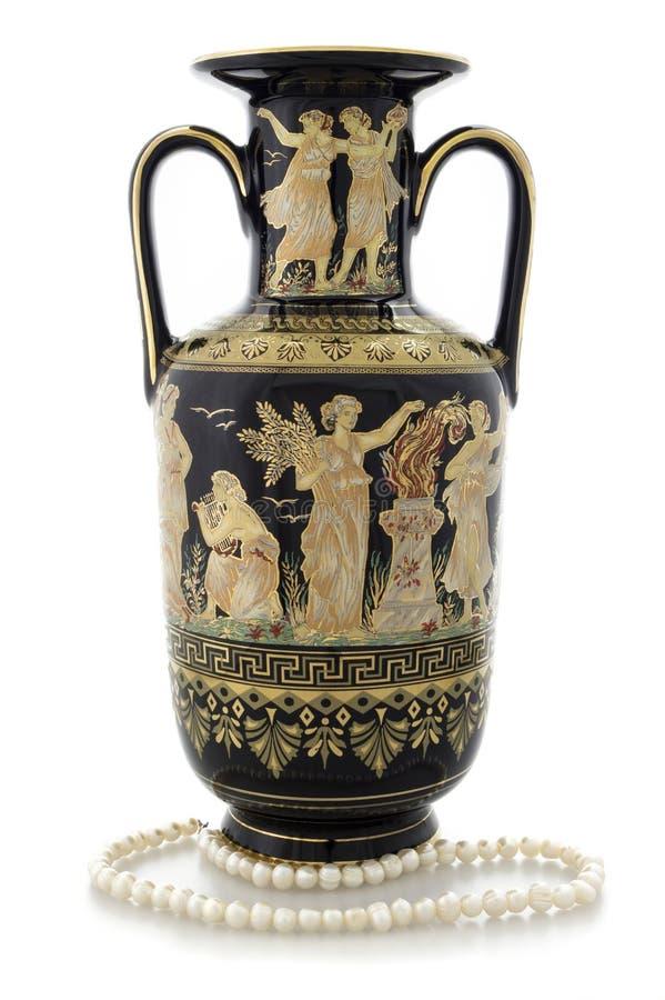 Antik vas på vit bakgrund royaltyfri bild