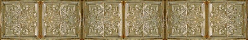 Antika guld- kulöra tenn- taktegelplattor arkivfoto