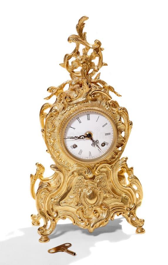 Antike goldish Borduhr. lizenzfreies stockbild