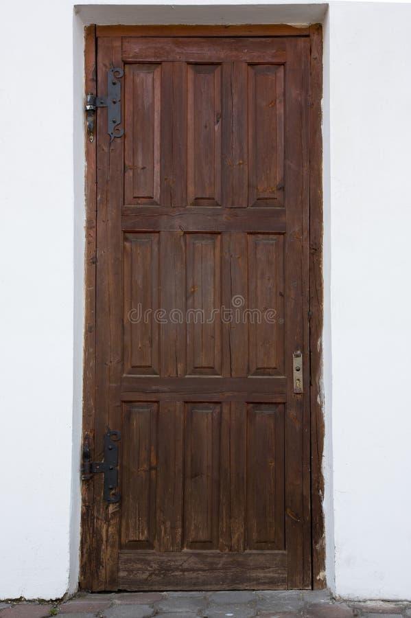Antike hölzerne Tür lizenzfreie stockfotografie