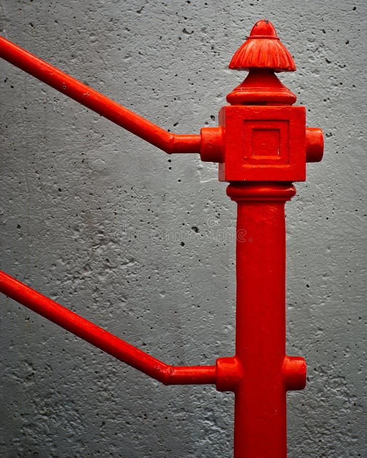 Antike, roter Eisen-Geländer-Detail-Aufbau lizenzfreies stockbild