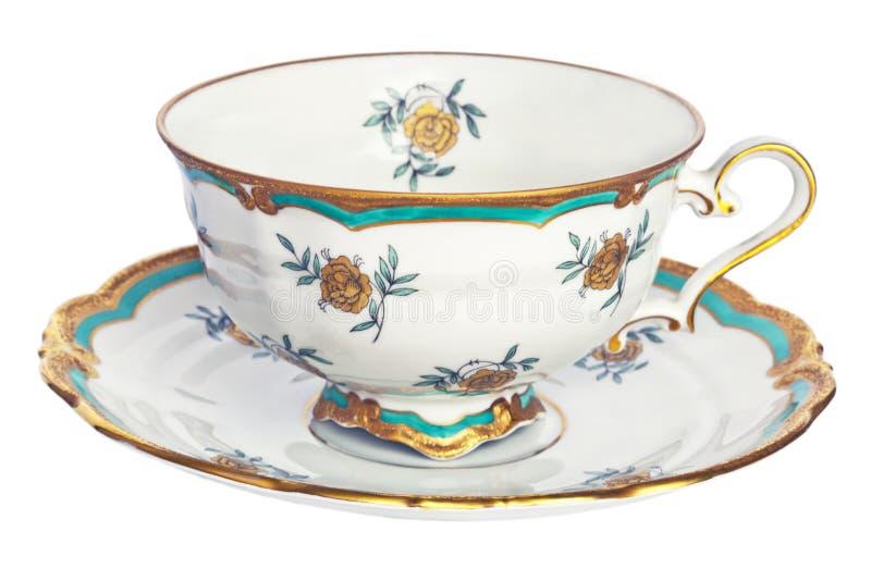 Antike Tee-Tasse und Untertasse. lizenzfreies stockbild