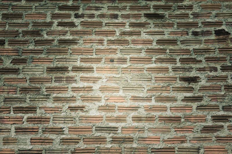 Antike Weinleseschmutz-Ziegelsteinwand lizenzfreie stockfotografie