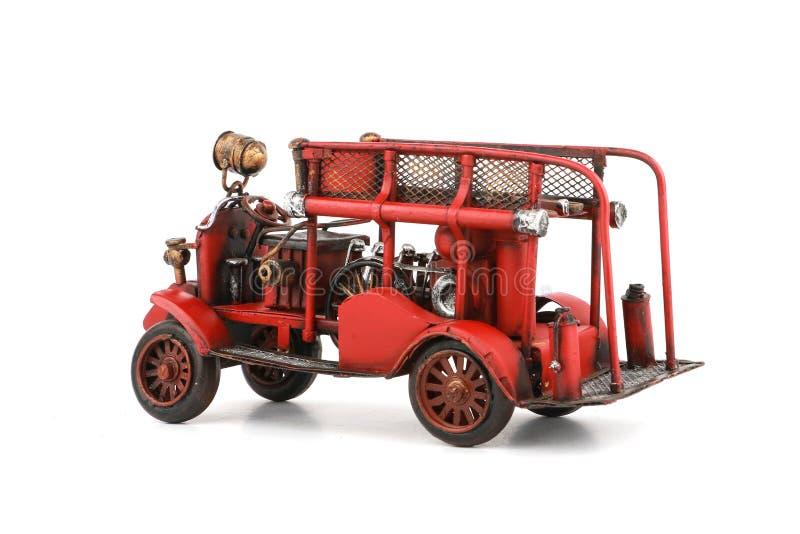 Antiker Toy Fire Engine auf dem weißen Hintergrund, lokalisiert lizenzfreie stockfotografie