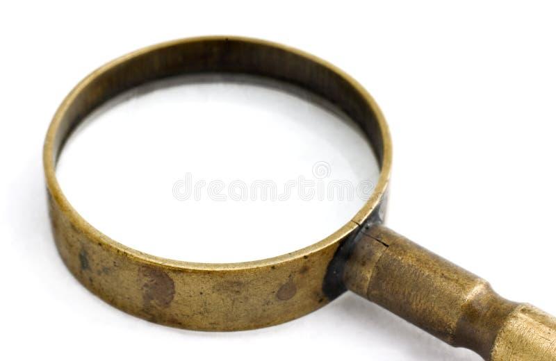 antikt exponeringsglas som förstorar arkivbilder