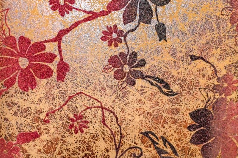 Antikt gammalt läder med textur för tappningblommabakgrund royaltyfria bilder
