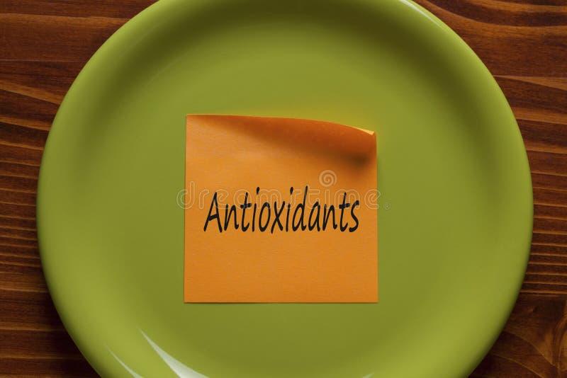 Antioxidantes escritos en una nota foto de archivo libre de regalías