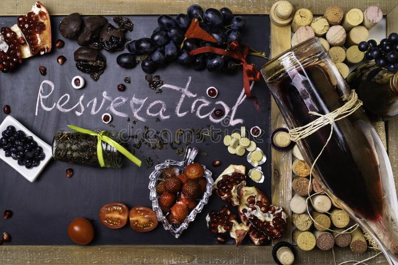antioxidants rich food, contains resveratrol, decorated with wine corks, pills vitamins royalty free stock images