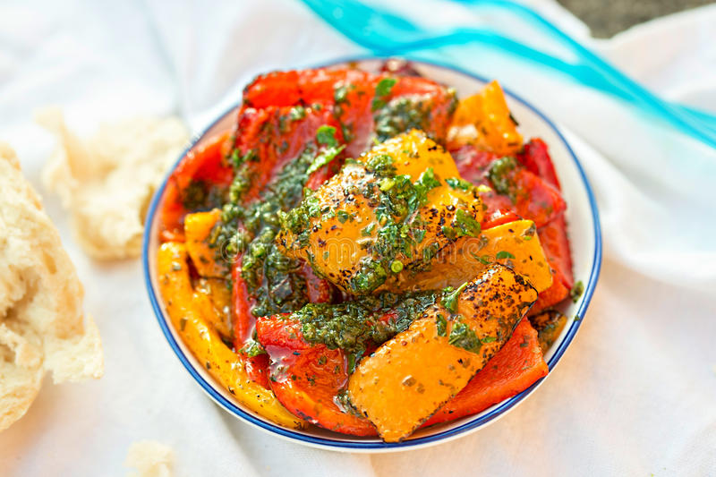 Antipasti - red, green and red peppers with green pesto royalty free stock images