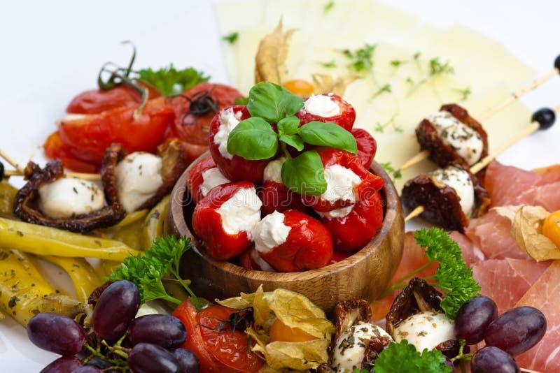 Antipasti variation. Variation of antipasti, olives, mozzarella cheese and tomatoes stock images