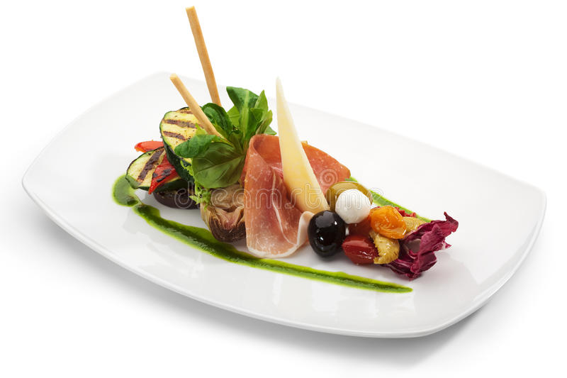 Antipasto. Italian meal. Includes Cured Meat, Artichoke, Parmesan Cheese, Olives and Zucchini royalty free stock images