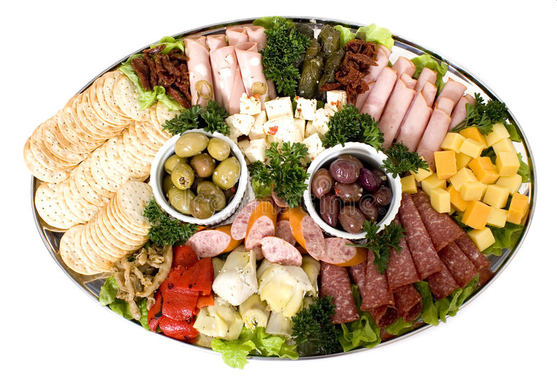 Antipasto catering platter. An antipasto catering platter of continental meats and feta cheese over a bed of mixed greens plus marinated artichoke hearts, olives stock photos