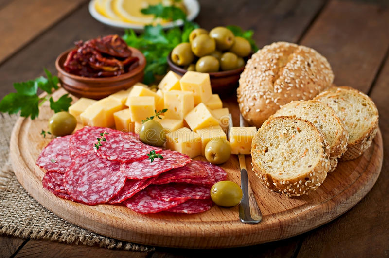 Antipasto catering platter with salami and cheese. On a wooden background stock photos